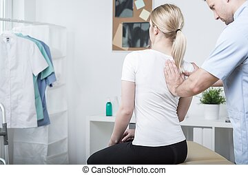 Chiropractic doing spinal mobilisation in physiotherapist's...