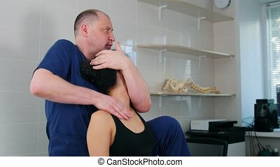 Chiropractic treatment - the doctor working with young woman...