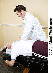 Chiropractor Adjusts Senior Man