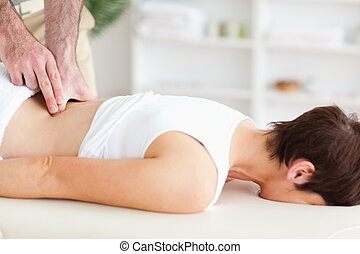 Chiropractor massaging a woman - A chiropractor is massaging...