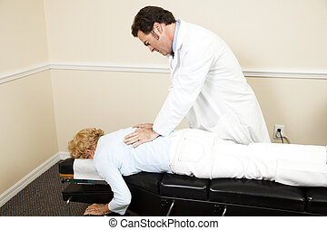 Chiropractor with Copyspace - Chiropractor adjusting a...