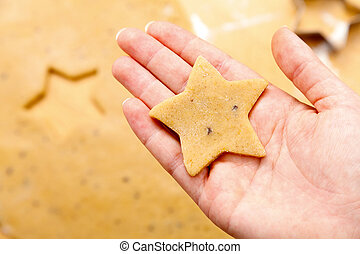 Chirstmas cookie - Woman holding a star cookie.