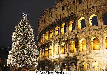 Chirstmas tree and Rome colosseum - the night view during ...