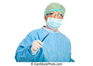 chirurg, vrouw, middelbare leeftijd , scalpel