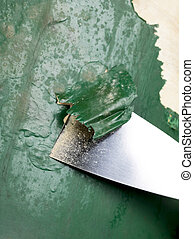 chisel scraping paint on the chair - Close-up image of a ...