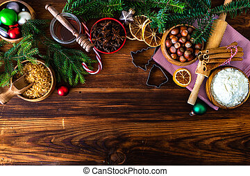 Christmas cooking concept with flour, brown sugar, nuts, cinnamon and anise star on wooden background