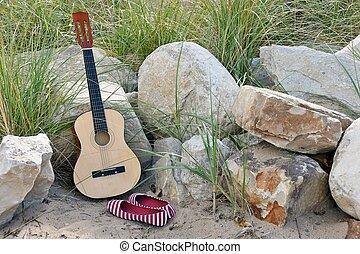 chitarra, sabbia, pietre