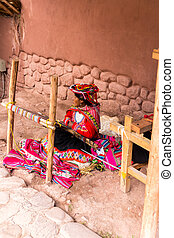 CHIVAY, AREQUPA, PERU - CIRCA 2013:An unidentified  woman sell hand crafts in outdoors circa 2013 in Chivay, Arequipa, Peru. Many women work selling handicrafts in Peru