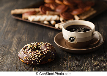 Choco donuts on wooden background.