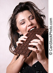 Chocoholic - Woman with a large block of chocolate