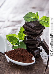 Chocolage, Mint and Cocoa on wooden background