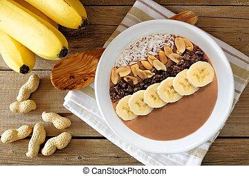 chocolat, peanut-butter, banane, smoothie, bol, aérien, scène, sur, rustique, bois, fond