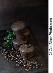 chocolate and coffee muffins on a dark wooden background