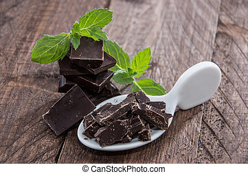 Chocolate and Mint on wooden background