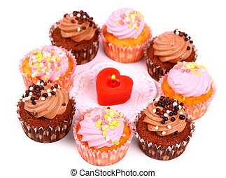 Chocolate and pink cup cakes with candle heart