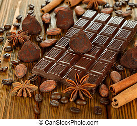 Chocolate and spices on a brown background close-up