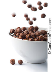chocolate balls falling into bowl isolated