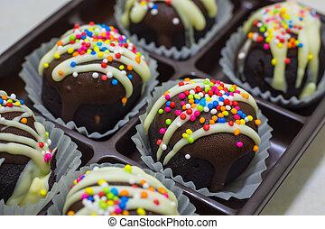 Chocolate balls in the box.