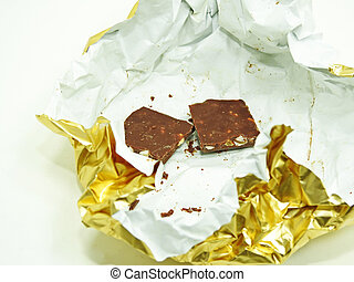 Chocolate bar in golden foil.