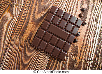 Chocolate bar on a wooden board.