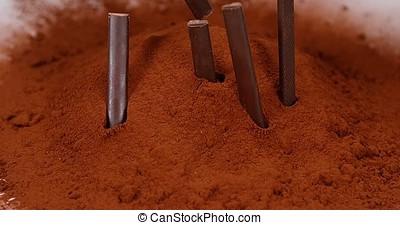 Chocolate Bars falling on Black Chocolate Powder, Slow motion 4K