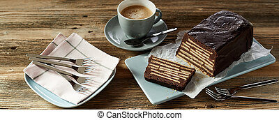 Chocolate biscuit cake served on wooden table