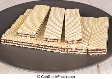 Chocolate biscuit wafer on grey wood