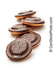 Chocolate biscuits with filling on white background