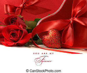 Chocolate boxes with red satin ribbons and roses