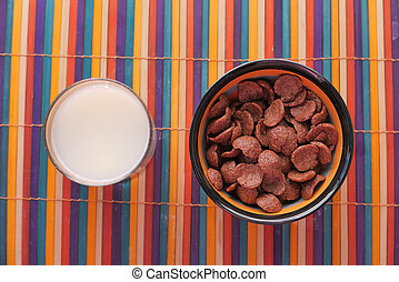 Chocolate breakfast cereal in a bowl on table.
