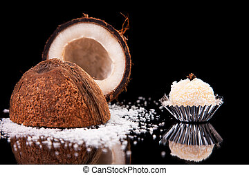 chocolate - brigadier of coconut, on black with reflexions
