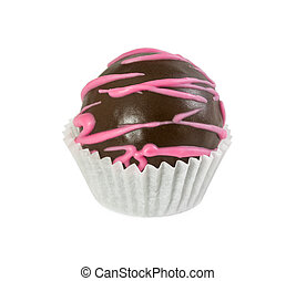 Chocolate cake ball with pink icing in paper form isolated...