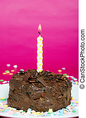 chocolate cake candle and confetti