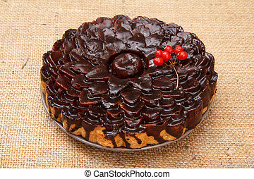 Chocolate cake decorated with bunch of viburnum