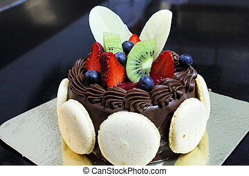 chocolate cake decorations with macaroon and freshfruit