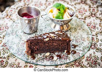 Chocolate cake, fruit and ice cream