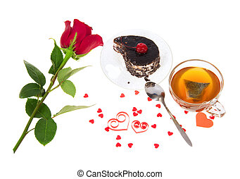 Chocolate cake, hot tea and red rose isolated on white