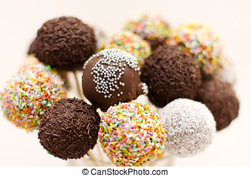 Chocolate cake pops with decoration.