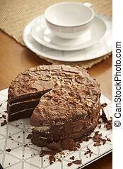 Chocolate cake still life with coffee or tea cup
