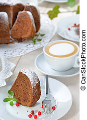 Chocolate cake with a cappuccino