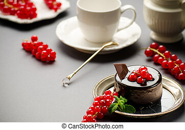 Chocolate cake with a red currant