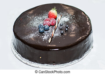 Chocolate cake with berries close up