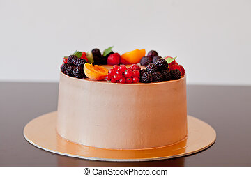 Chocolate cake with berries on the table