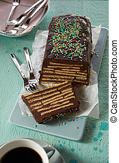 Chocolate cake with biscuits and topping