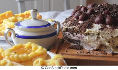 Chocolate cake with cherries, grated chocolate and whipped...