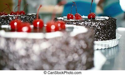 chocolate cake with cherries in a candy store