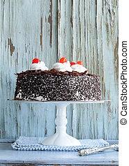 Chocolate cake with cherries and whipped cream (Black...