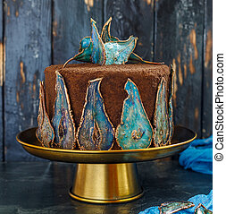 Chocolate cake with dried pears decoration.