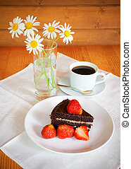 Chocolate cake with fresh strawberry and a cup of coffee