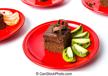 Chocolate cake with fruit on a plate